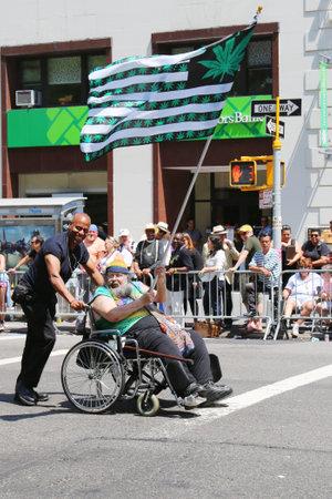 wedding parade: NEW YORK - June 29, 2014: Medical marijuana supporter during LGBT Pride Parade in New York City