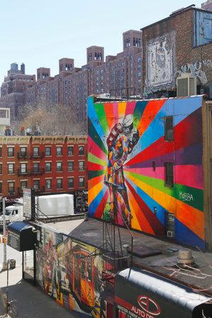 chelsea: NEW YORK - MARCH 12, 2015: Mural art by Brazilian Mural Artist Eduardo Kobra in Chelsea neighborhood in Manhattan. The mural is based on Alfred Eisenstaedt s 1945 photo from V-J Day in Times Square