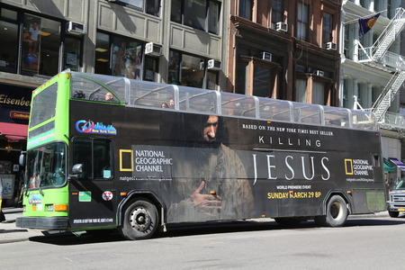NEW YORK - MARCH 12, 2015: Go NY tour Hop on Hop off bus with Killing Jesus TV premier advertisement in Manhattan. Go NY tours provides variety of New York City tours on Double Decker buses