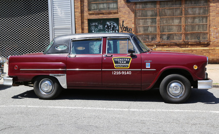 checker: BROOKLYN, NY - JUNE 21, 2014: Checker Marathon taxi car produced in 1982  by the Checker Motors Corporation. The Checker remains the most famous taxi cab vehicle in the United States