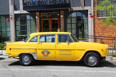 checker: BROOKLYN, NY - JUNE 21, 2014: Checker Marathon 1976 A-11 taxi car produced by the Checker Motors Corporation. The Checker remains the most famous taxi cab vehicle in the United States Editorial