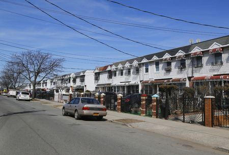 residential neighborhood: BROOKLYN, NEW YORK - MARCH 19, 2015: Typical houses at Coney Island in Brooklyn. Coney Island is a peninsular residential neighborhood in the southwestern part of the borough of Brooklyn