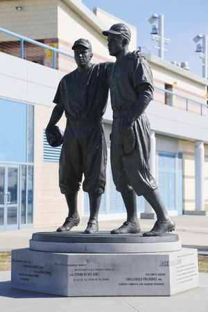 dodgers: BROOKLYN, NEW YORK - MARCH 19, 2015: Jackie Robinson and Pee Wee Reese Statue in Brooklyn in front of MCU ballpark Editorial