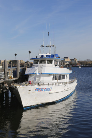 charter: BROOKLYN, NEW YORK - MARCH 19, 2015: Fishing boat charter on Sheeprshead Bay Marina in Brooklyn Editorial