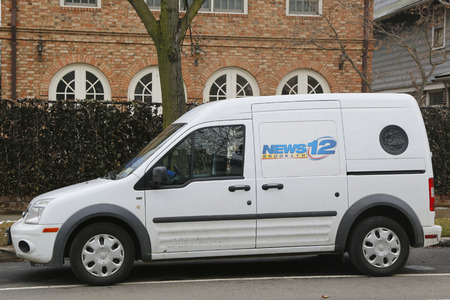 BROOKLYN, NEW YORK - MARCH 21, 2015:  News 12 van in Brooklyn. The News 12 Networks are a group of American regional cable news television channels