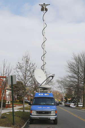 BROOKLYN, NEW YORK - MARCH 21, 2015: CBS Channel 2 HD News van in Brooklyn. WCBS-TV, channel 2, is the flagship station of the CBS Television Network, located in New York City
