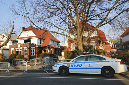 police unit: BROOKLYN, NEW YORK - MARCH 21, 2015: NYPD car in the front of burnt house after fire sparked by hot plate killed seven children in Midwood, Brooklyn