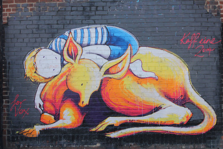 NEW YORK - MARCH 24, 2015: Mural art in Astoria section of Queens. A mural is any piece of artwork painted or applied directly on a wall, ceiling or other large permanent surface