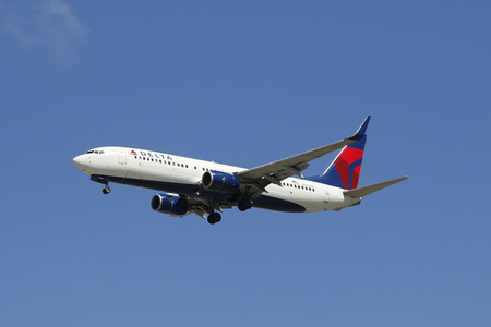 california delta: SAN DIEGO, CALIFORNIA - SEPTEMBER 27, 2014: Delta Airlines Boeing 737 jet descending for landing San Diego International Airport.