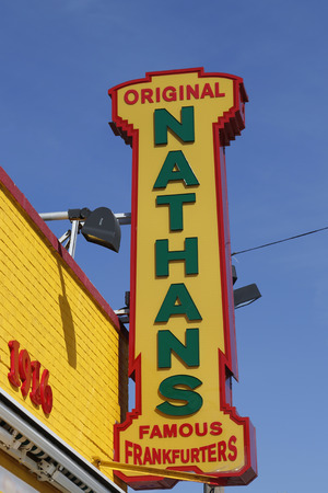 BROOKLYN, NEW YORK - MARCH 19, 2015 : The Nathan s original restaurant sign at Coney Island, New York. The original Nathan s still exists on the same site that it did in 1916 Editorial