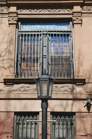 brownstone: Vintage gas lamp in the front of New York City brownstone Stock Photo