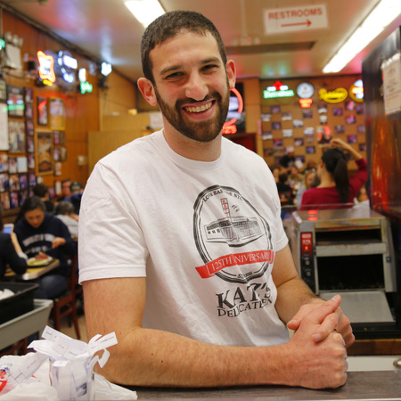 est: NEW YORK  - APRIL 14, 2015: Jake Dell, 27-year-old owner of  the Historical Katz s Delicatessen (est. 1888), a famous restaurant, known for its Pastrami sandwiches in Lower East Side in Manhattan