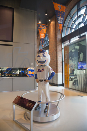 outfield: FLUSHING, NY - MAY 18, 2014: New York Mets mascot, Mr. Met, on display at the  Citi Field, home of major league baseball team the New York Mets. This stadium was opened in 2009 in Flushing, NY.