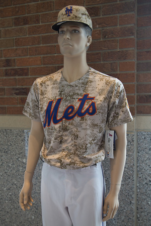flushing: FLUSHING, NY - MAY 18, 2014: New York Mets uniform on display at the  Citi Field, home of major league baseball team the New York Mets. This stadium was opened in 2009 in Flushing, NY. Editorial