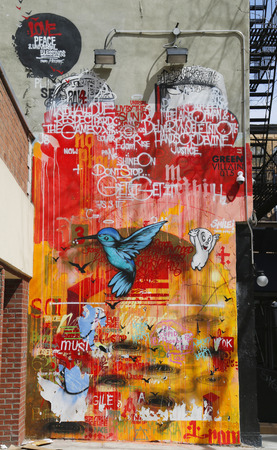 NEW YORK - APRIL 14, 2015: Mural art at Houston Avenue in Soho. A mural is any piece of artwork painted or applied directly on a wall, ceiling or other large permanent surface