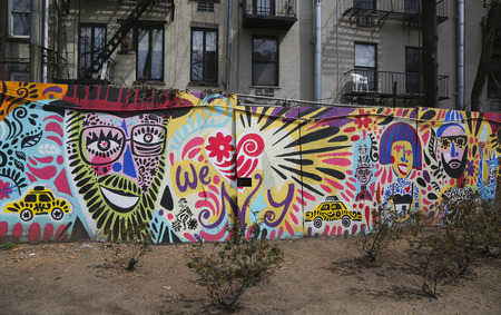 bowery: NEW YORK - APRIL 14, 2015: Mural art at Houston Avenue in Soho. A mural is any piece of artwork painted or applied directly on a wall, ceiling or other large permanent surface