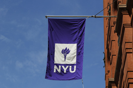wagner: NEW YORK - APRIL 18, 2015: NYU flag on historic Puck Building  at Wagner Graduate School of Public Service in Lower Manhattan Editorial