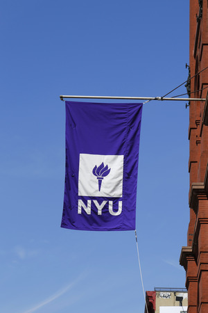NEW YORK - APRIL 18, 2015: NYU flag on historic Puck Building  at Wagner Graduate School of Public Service in Lower Manhattan Editorial