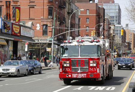 lower east side: NEW YORK - APRIL 18, 2015: FDNY Ladder 18 in Lower East Side in Manhattan. FDNY is the largest combined Fire and EMS provider in the world