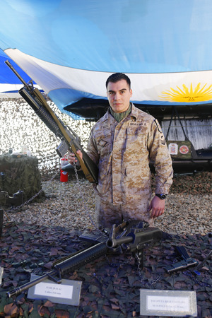 falklands war: USHUAIA ARGENTINA  APRIL 2 2015:  Argentinian Marine with firearm in Ushuaia Argentina during  Malvinas Day Celebration Editorial