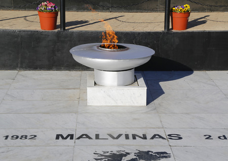 falklands war: USHUAIA ARGENTINA  APRIL 2 2015: Eternal Flame at  Malvinas War Monument in Ushuaia Argentina Editorial