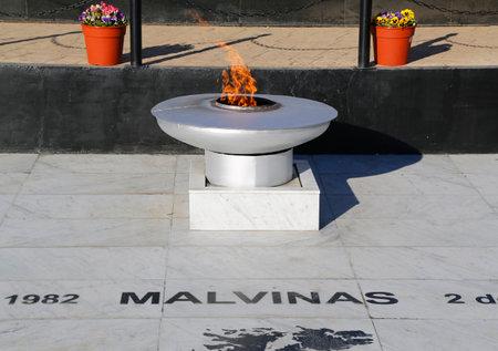 eternal: USHUAIA ARGENTINA  APRIL 2 2015: Eternal Flame at  Malvinas War Monument in Ushuaia Argentina Editorial