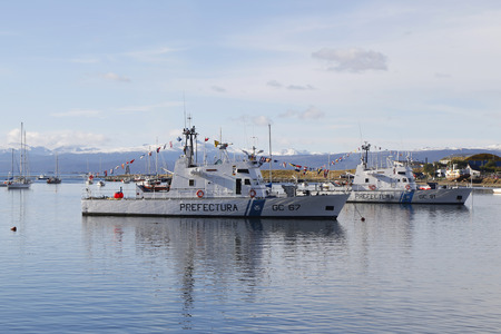81: USHUAIA ARGENTINA  APRIL 2 2015: Argentinian Coast Guard boats GC 67 Rio Uruguay Class and GC 81 Canal de Beagle the Naval Prefecture Argentina in Ushuaia Harbor during Malvinas Day Celebration