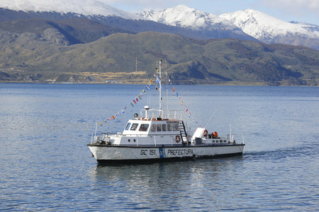 huapi: USHUAIA ARGENTINA  APRIL 2 2015: Argentinian Coast Guard boat GC 151 Nahuel Huapi Stan Tender 2200 class the Naval Prefecture Argentina in Ushuaia Harbor during Malvinas Day Celebration