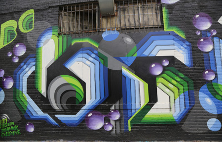 collective: NEW YORK - MAY 5, 2015: Mural art at East Williamsburg in Brooklyn. Outdoor art gallery known as the Bushwick Collective has most diverse collection of street art in Brooklyn