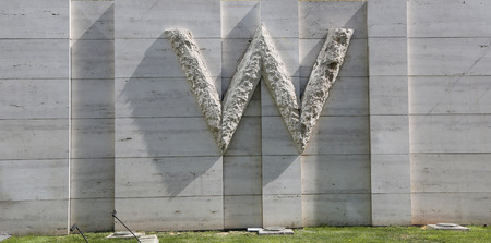 SANTIAGO DE CHILE - APRIL 12, 2015: Big W sign at W Hotel in Santiago de Chile. W Hotels and  Resorts are a luxury hotel chain owned by Starwood Hotels & Resorts Worldwide