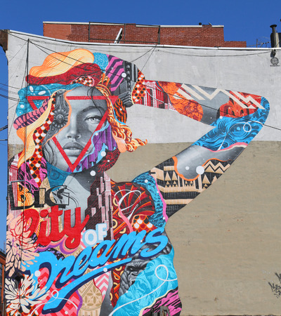 NEW YORK  MAY 14 2015: Mural art City of Dreams by Tristan Eaton in Little Italy