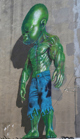 NEW YORK  MAY 14 2015: Temper Tot mural by Ron English in Little Italy in Manhattan. A mural is any piece of artwork painted or applied directly on a wall ceiling or other large permanent surface