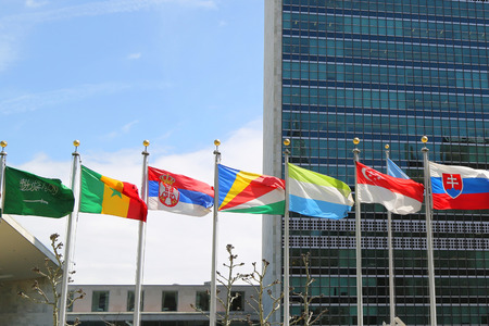 headquarter: NEW YORK CITY  APRIL 30 2015: International Flags in the front of United Nations Headquarter in New York