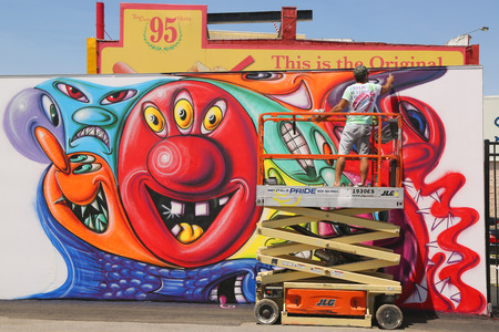 coney: NEW YORK  JUNE 7 2015: Street artist painting mural at new street art attraction Coney Art Walls at Coney Island section in Brooklyn