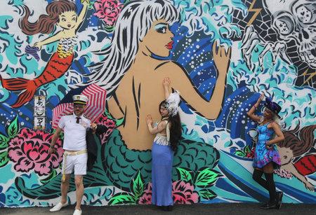 coney: NEW YORK  JUNE 20 2015: Mermaid Parade participants at Coney Island in Brooklyn. The Coney Island Mermaid Parade is a parade that celebrates the beginning of the summer season in Coney Island NY Editorial