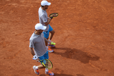 grand slam: PARIS FRANCE MAY 29 2015: Grand Slam champions Mike and Bob Bryan of United States in action during second round match at Roland Garros 2015 in Paris France Editorial