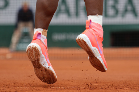 nike: PARIS, FRANCE- MAY 28, 2015: Nineteen times Grand Slam champion Serena Willams wears custom Nike tennis shoes during second round match at Roland Garros 2015 in Paris, France