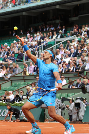 nadal: PARIS FRANCE MAY 28 2015:Fourteen times Grand Slam champion Rafael Nadal in action during second round match at Roland Garros 2015 in Paris France Editorial