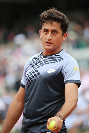 almagro: PARIS, FRANCE- MAY 28, 2015 :Professional tennis player Nicolas Almagro of Spain in action during his second round match at Roland Garros 2015 in Paris, France Editorial