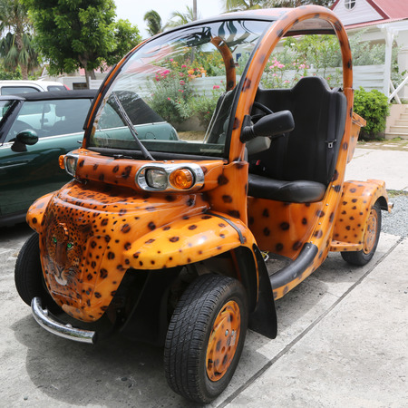 custom car: ST BARTHS, FRENCH WEST INDIES - JUNE 13, 2015: Custom design GEM E2 electrical car at St Barths. GEM is a US manufacturer in the low-speed vehicle category, producing electric vehicles since 1998 Editorial