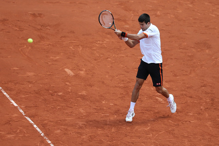 serb: PARIS, FRANCE- MAY 30, 2015: Eight times Grand Slam champion Novak Djokovic in action during his third round match at Roland Garros 2015 in Paris, France