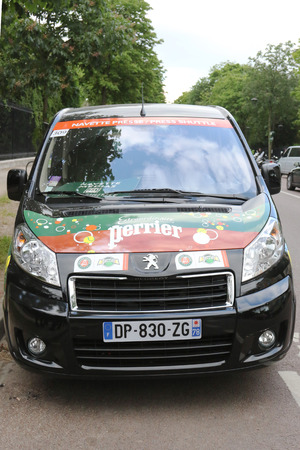 26 30 years: PARIS, FRANCE- MAY 26, 2015: Peugeot van with Perrier logo at Le Stade Roland Garros in Paris. Perrier and Peugeot are Official Partners of the tournament for more than 30 years
