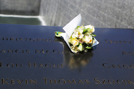 NEW YORK - JULY 11, 2015: Flowers left at the National September 11 Memorial at Ground Zero in Lower Manhattan