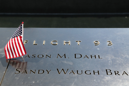 NEW YORK - JULY 11, 2015: American Flag left at the National September 11  Memorial at Ground Zero in Lower Manhattan Redakční