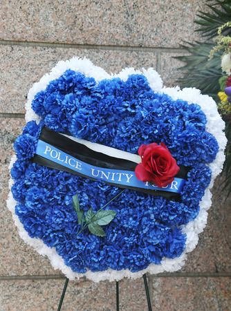 strongest: NEW YORK - JULY 11, 2015: Police Unity Tour wreath at New York City Police Memorial. Memorial created in honor of those who lost their lives in the line of duty and  was dedicated on October 20, 1997