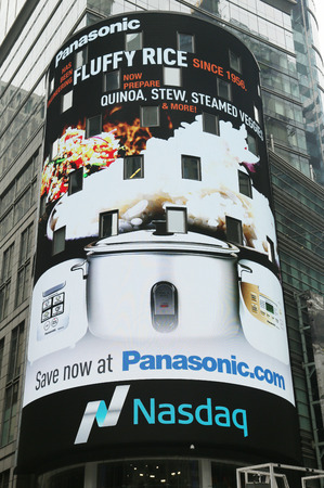 nasdaq: NEW YORK CITY - JUNE 9, 2015 The headquarters of the NASDAQ Stock Exchange, the second largest trading market in the world in Times Square Editorial