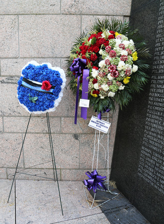 the memorial: NEW YORK - JULY 11, 2015: Police Unity Tour wreath at New York City Police Memorial. Memorial created in honor of those who lost their lives in the line of duty and  was dedicated on October 20, 1997