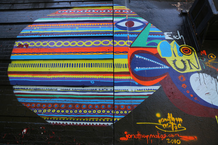lower east side: NEW YORK - JUNE 16, 2015: Mural art at Lower East Side in  Manhattan. A mural is any piece of artwork painted or applied directly on a wall, ceiling or other large permanent surface