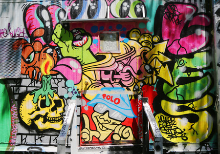 bowery: NEW YORK - JUNE 16, 2015: Mural art at Houston Avenue in Lower Manhattan. A mural is any piece of artwork painted or applied directly on a wall, ceiling or other large permanent surface