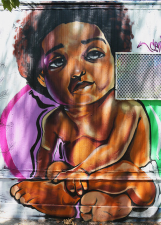 NEW YORK - JUNE 16, 2015: Mural art at Houston Avenue in Lower Manhattan. A mural is any piece of artwork painted or applied directly on a wall, ceiling or other large permanent surface